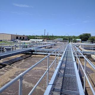 Water facility treatment plant via bridge